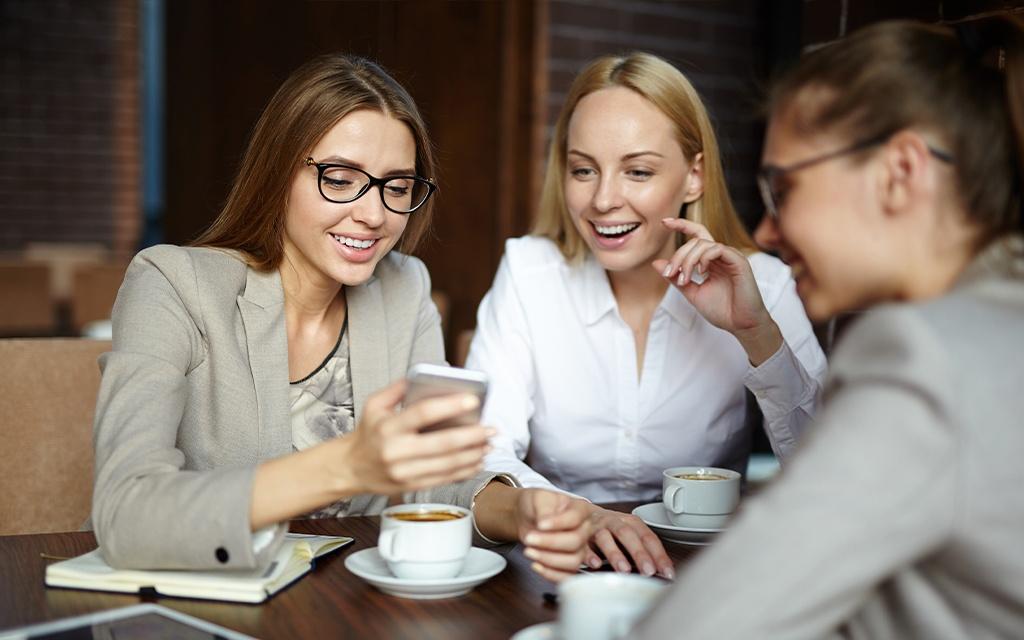 happy girls drinking Italian coffee